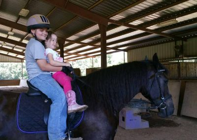 friesian-horseback-riding-children